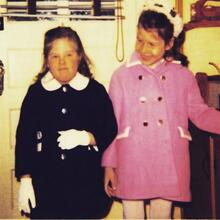 A photo of two young girls in coats (Chris and Dianne Bilyak, 1971)